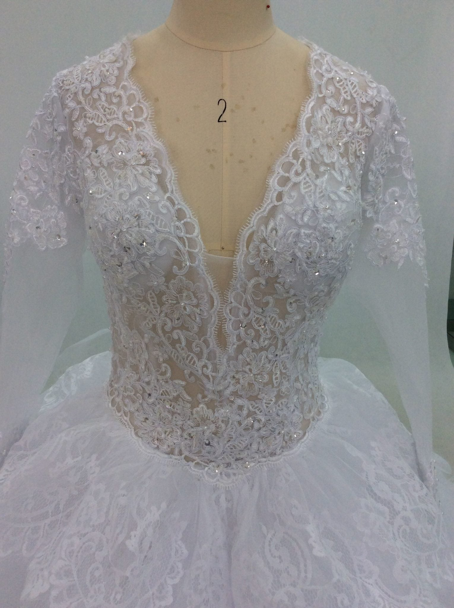 70a39c644b Style #C2018-Carroll V-neck lace wedding dresses from Darius Cordell