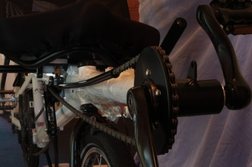 The stoker's pedals on the end of an adjustable length boom.