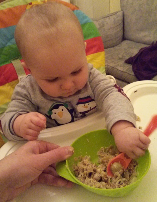 Owen eating sprouts
