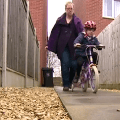 Toddler cycling on pavement