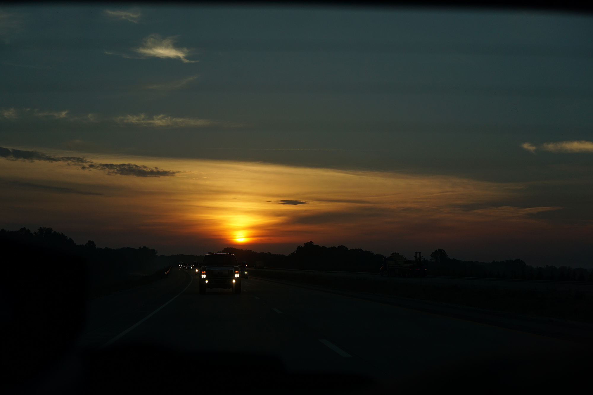 Sunrise from the back window of the car, southern Indiana / Darker than Green