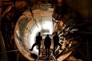 Urban explorers in underground tunnel