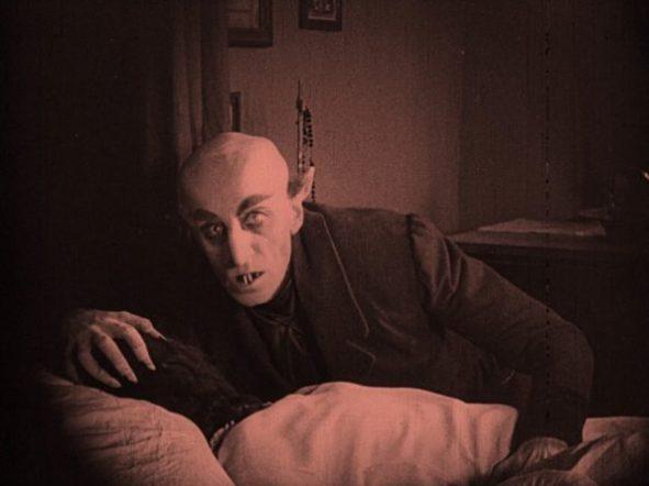 nosferatu-1922-max-schreck-as-count-orlok-feasting-on-his-victim-1024x765