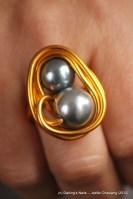 Bague 2 perles grises prix : 7 €