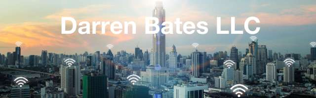 Picture: Urban Skyline at Dawn; Text: Darren Bates LLC