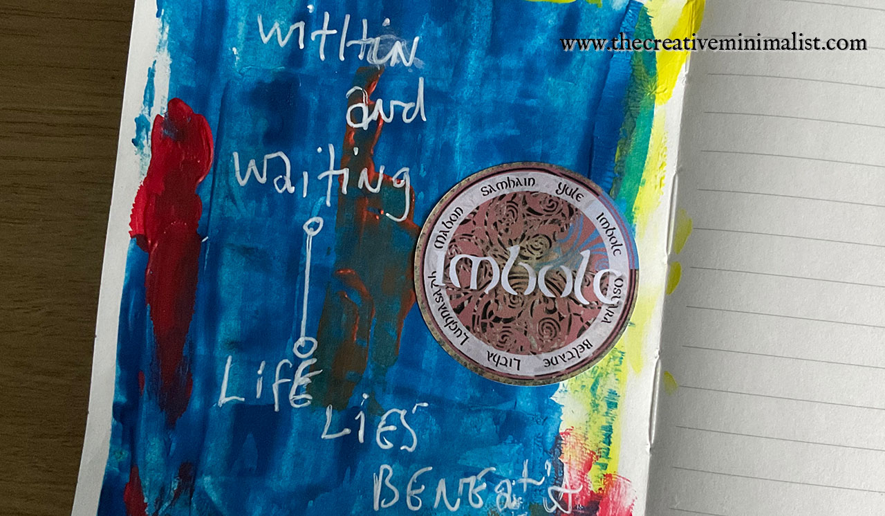 imbolc journal page with the words within and waiting, life lies beneath