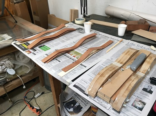 Pre-bent laminate strips made on a hot pipe