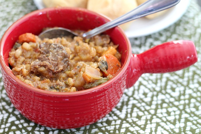 Easy comfort food classic Beef Stew with an added kick from Guinness beer. Full of veggies and slow-cooked beef, this stew can't be beat! Barley adds a little texture to this thick stew. via @DashOfEvans