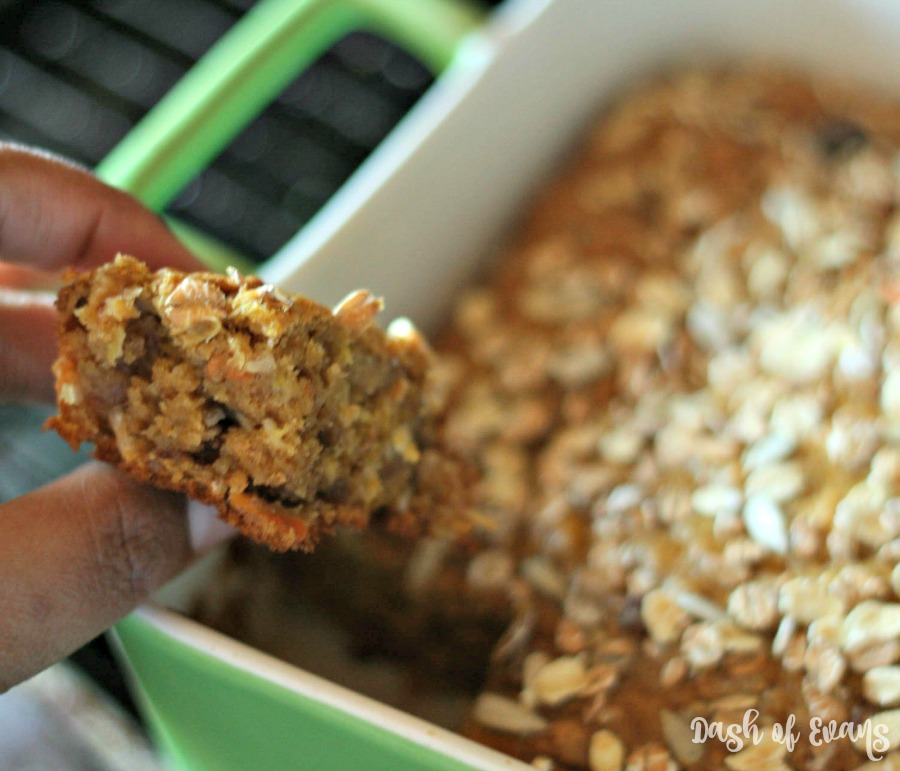 Muesli isn't just for your yogurt! These baked Banana Carrot Bars are healthy AND delicious! Made lighter with pumpkin, coconut oil this is a guilt free treat that tastes just like carrot cake! via @DashOfEvans