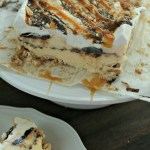 Looking for a new ice cream cake? Try this Caramel Fudge Crunch Ice Cream Cake! Using Blue Bunny® Homemade Vanilla, it's the perfect treat! via @DashOfEvans (ad) #SoFabFood #SoHoppinGood #TopYourSummer