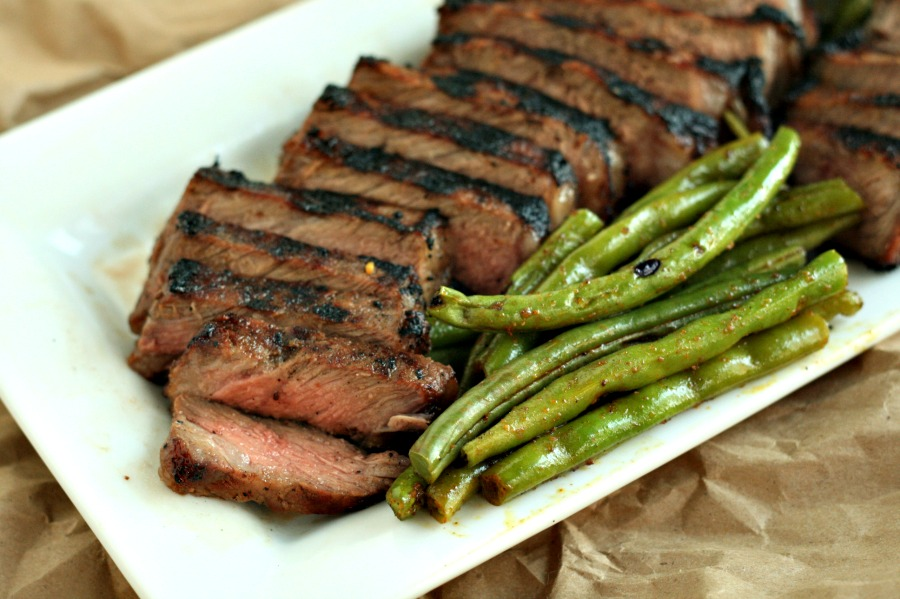 Looking for a perfect grilled steak? This Whiskey Brown Sugar steak has you covered--thanks to Carla Hall's awesome marinade! via @DashOfEvans