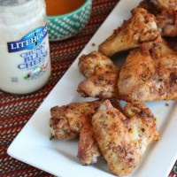 Crispy Baked Chicken Wings...perfect to dip in Litehouse blue cheese dressing! YUM! via @DashOfEvans
