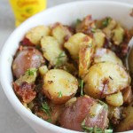 This warm potato salad is sure to be a hit at your next cookout! Plus, the combo of bacon and a tangy Coleman's dressing can't be beat! via @DashofEvans #HotMessAround (ad)