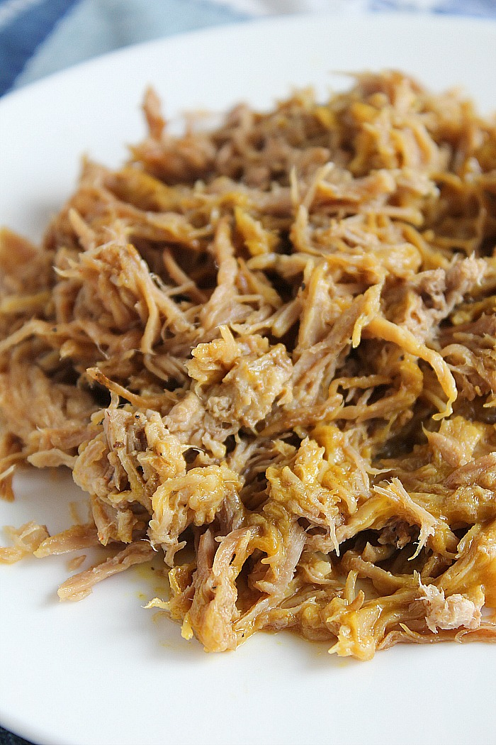 The BEST Slow-Cooker Pulled Pork recipe around...be prepared for everyone to be asking for the recipe! via @DashOfEvans #HotMessAround