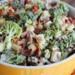 Classic and crunchy Broccoli salad is lightened up with yogurt and extra crunch of Honeycrisp apples. YUM! Perfect side dish for summer and BBQs. via @DashOfEvans