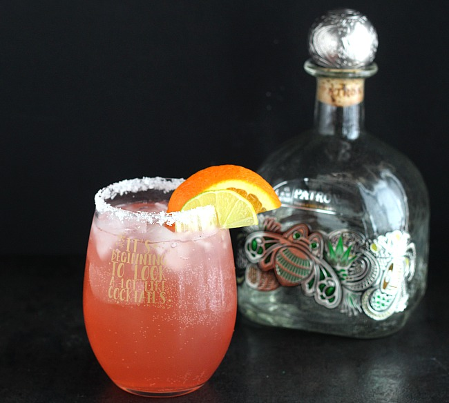 Perfect cup of holiday cheer: Cranberry Patrón Margarita. Easy to make and delish for your holiday party or dinner! via @DashOfEvans