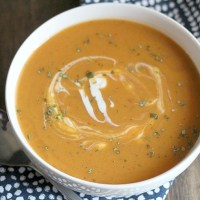Creamy sweet potato soup with a kick of spice from chipotles in adobo! YUM! This is perfect for your next Meatless Monday or a healthy lunch. via @DashOfEvans #OXO