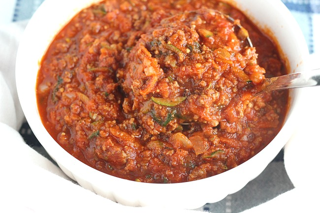 Looking for the perfect meat sauce with a slow cooked taste in less time? Try this easy pressure cooker Italian sauce filled with veggies. Super hearty, perfect for spaghetti or baked pasta dishes! via @DashOfEvans