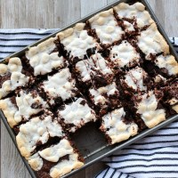 Looking for a show stopping dessert? These S'more Brownies with an Elvis twist are always a hit! Using a bit of bacon and peanut butter, these are a must try! via @DashOfEvans