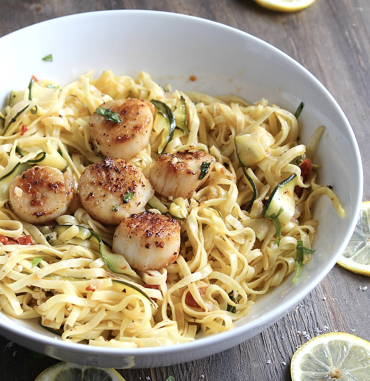 Looking for a great, fancy fakeout meal for a date night IN? This Linquine with Scallops is light and perfect! The shreds of zucchini add a bit of crunch and lemon zest pairs perfectly with the buttery scallops. YUM! via @DashOfEvans