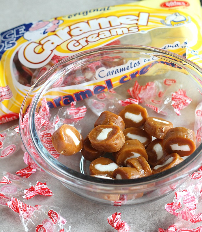 Love the snack mix of candy corn and peanuts? Try those flavors in blondie form, plus gooey Caramel Creams! Perfect snack for Halloween! via @DashOfEvans