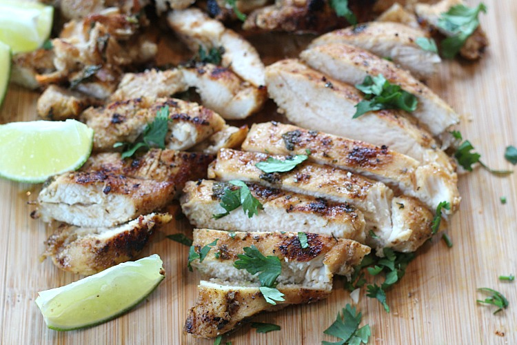Looking for a low carb meal for the summer? This easy Mojo chicken marinade can't be beat! Use the grilled chicken for salads, snacks or a filling meal. Try the cheesy charred veggies as a new go-to low carb side! via @DashOfEvans