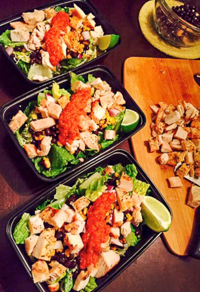 three chopped Southwestern salads with salsa and lime wedges