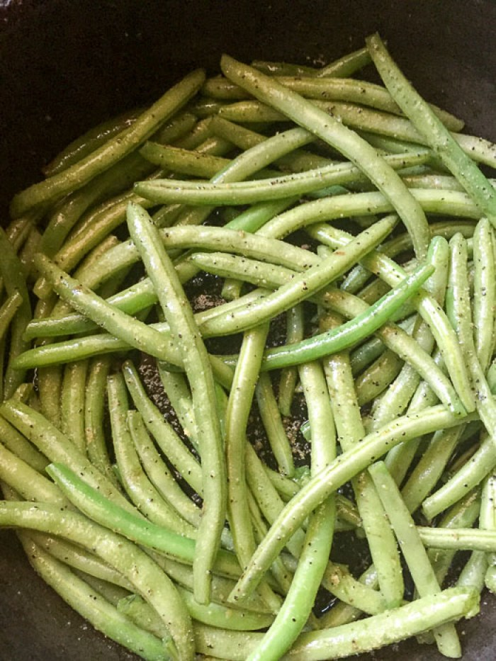 seasoned green beans cooking in pan