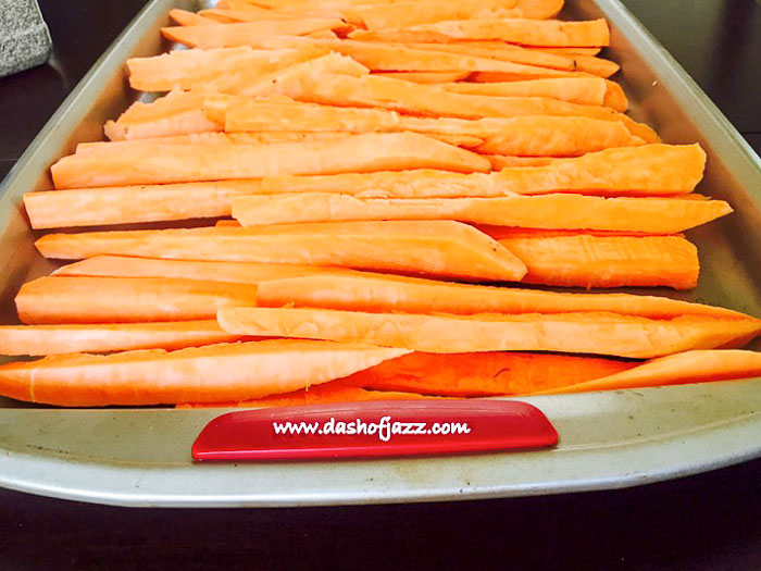 cut sweet potatoes on baking sheet