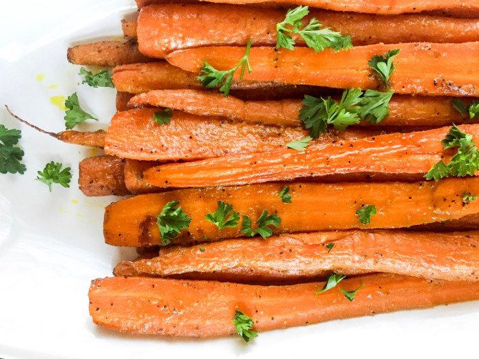 ginger curry carrots garnished with fresh, chopped parsley