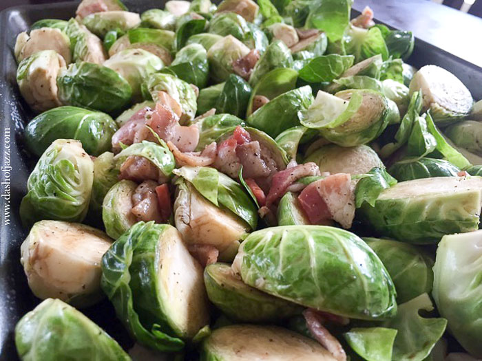brussels sprouts and bacon on pan before roasting