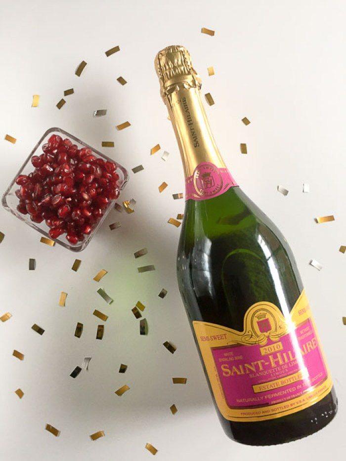 The pomegranate champagne cocktail is a festive, sparkling way to celebrate the holidays and bring in the new year. Get the easy, 4-ingredient recipe by Dash of Jazz