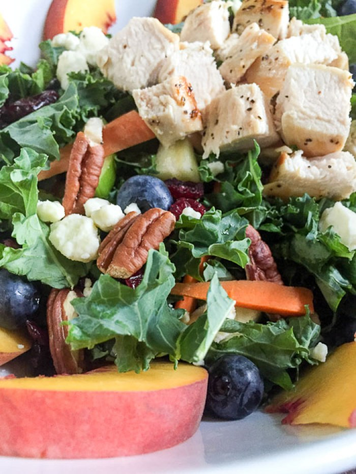 delicious homemade salad with fresh fruit, chicken breast, nuts, and cheese