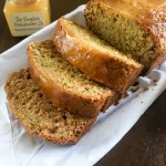 This Lemon Zucchini Bread is flavorful thanks to tangy lemon zest and luxury lemon curd. Check out the easy recipe and make it for yourself! by Dash of Jazz