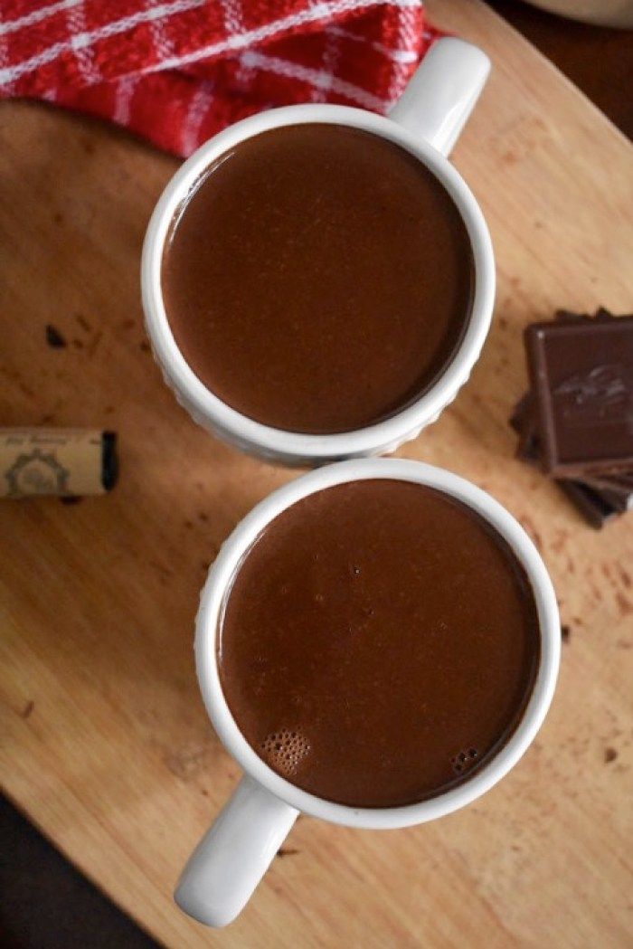 overhead view of two mugs of red wine hot cocoa