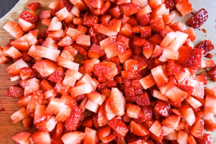 diced strawberries on cutting board