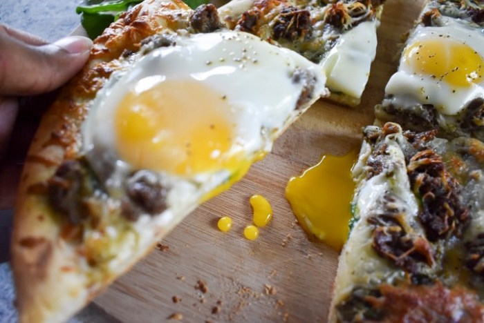 brunch pizza slice with runny egg