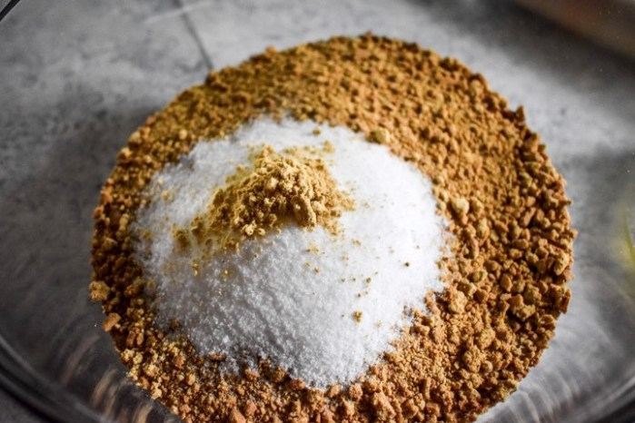 crushed graham cracker, sugar, an ground ginger in bowl