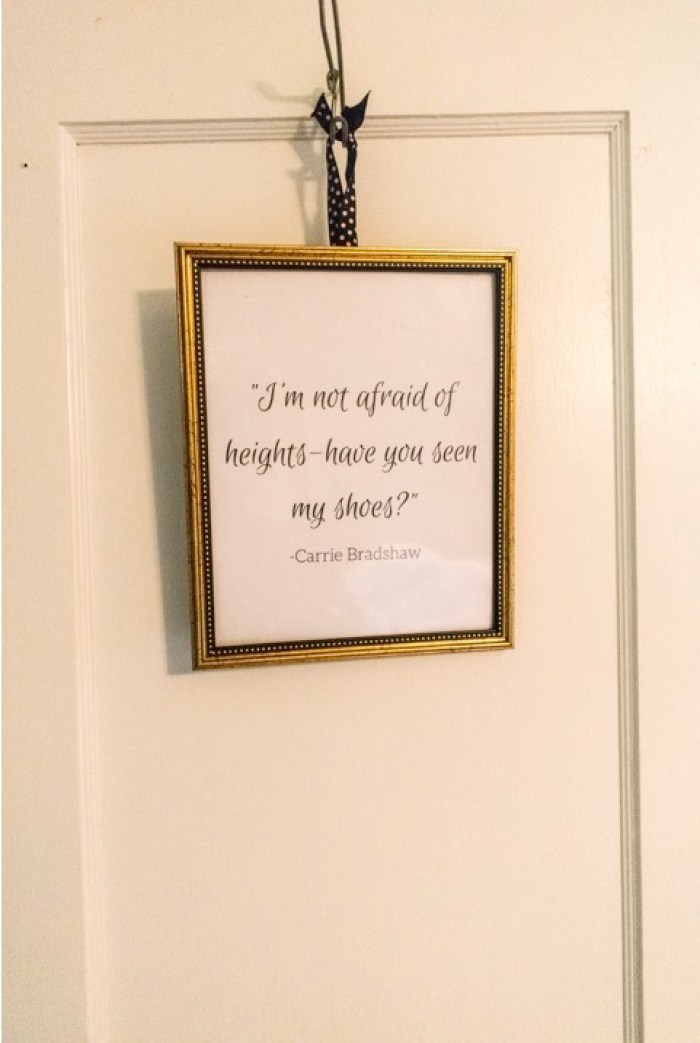 Framed Carrie Bradshaw quote hanging in shoe closet