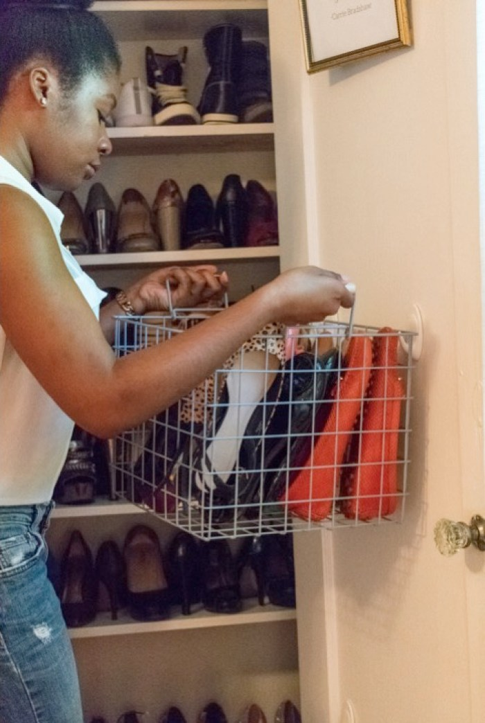 Dash of Jazz installing shoe closet baskets on door
