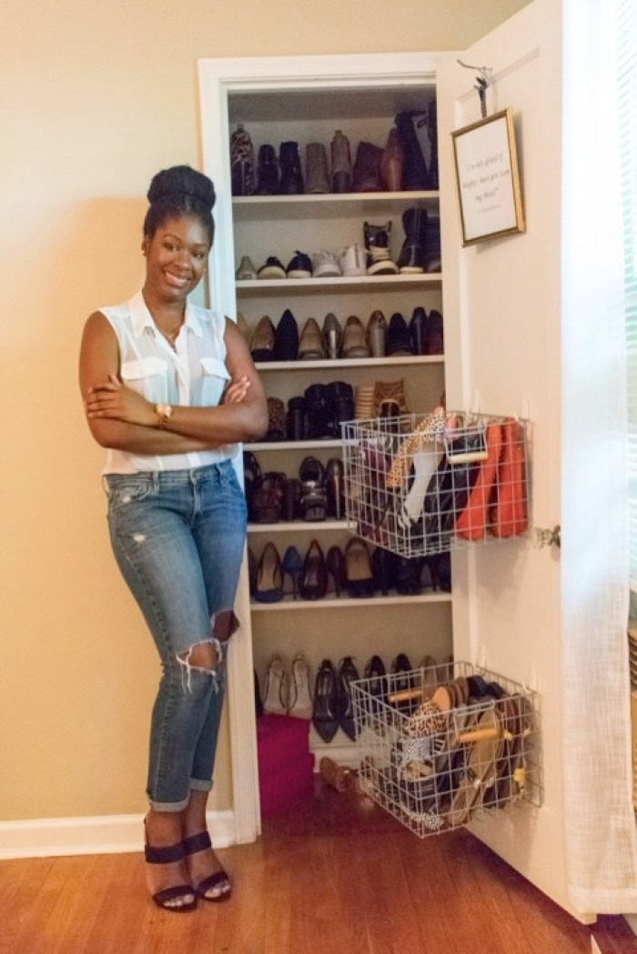 Dash of Jazz standing next to completed shoe closet project
