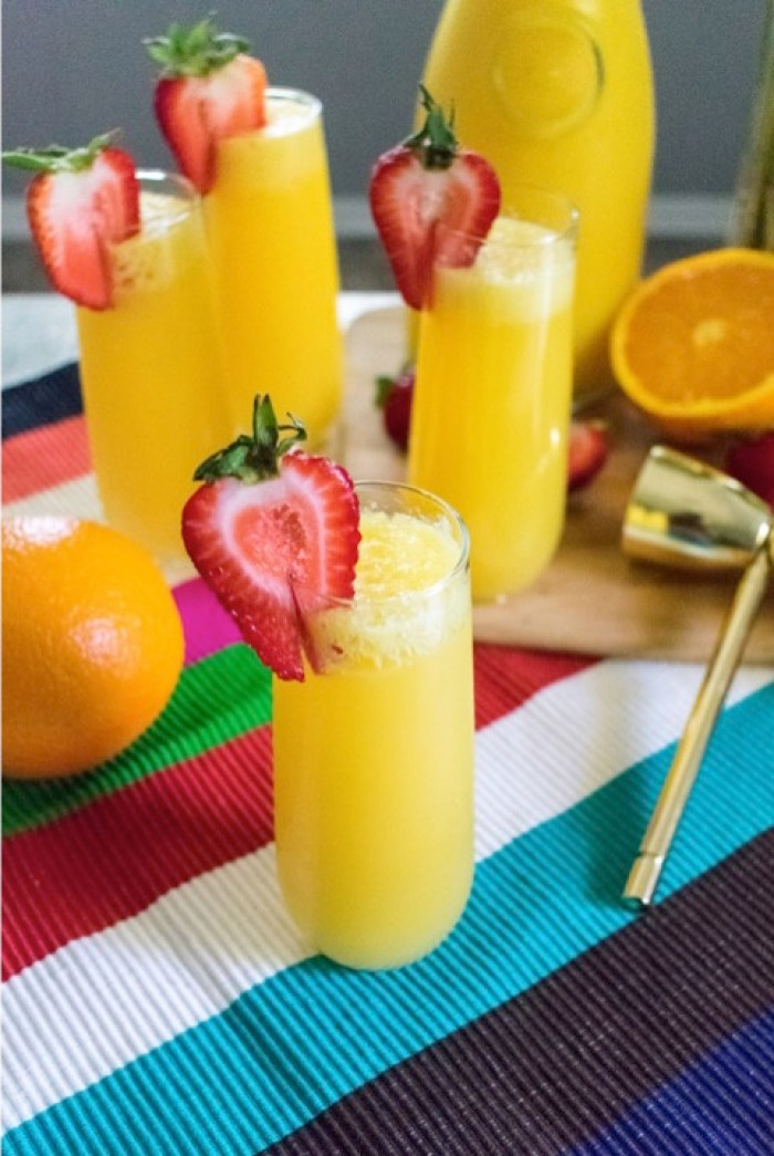 turnt tequila mimosas garnished with strawberries