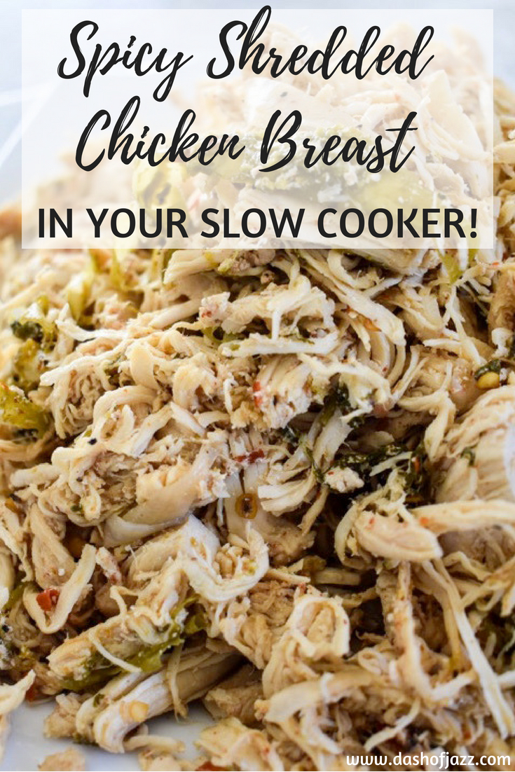 Step up your Taco Tuesday. Slow cooker spicy shredded chicken is perfect for adding to casseroles, tacos, and more made easily in a crock pot. Recipe by Dash of Jazz #dashofjazzblog #crockpotchickenrecipes #crockpotshreddedchickentacos #chickentacosrecipe