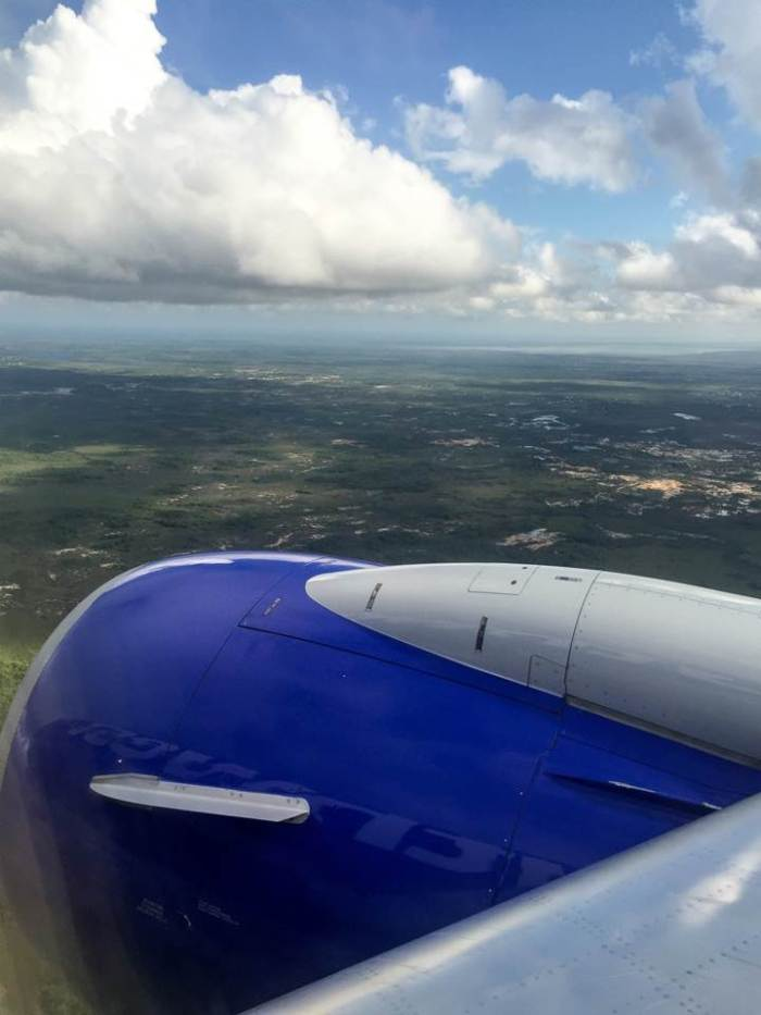 view from plane window descending into Belize City, Belize