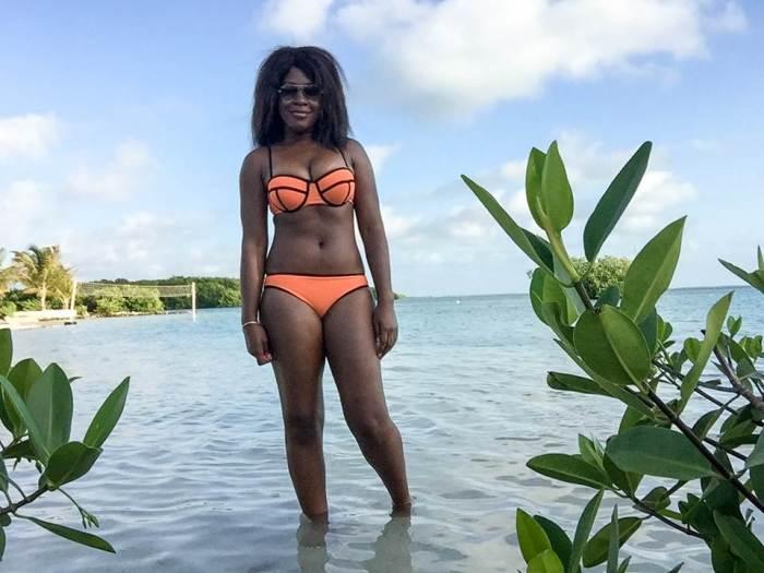 Dash of Jazz in orange bikini at the beach in Belize