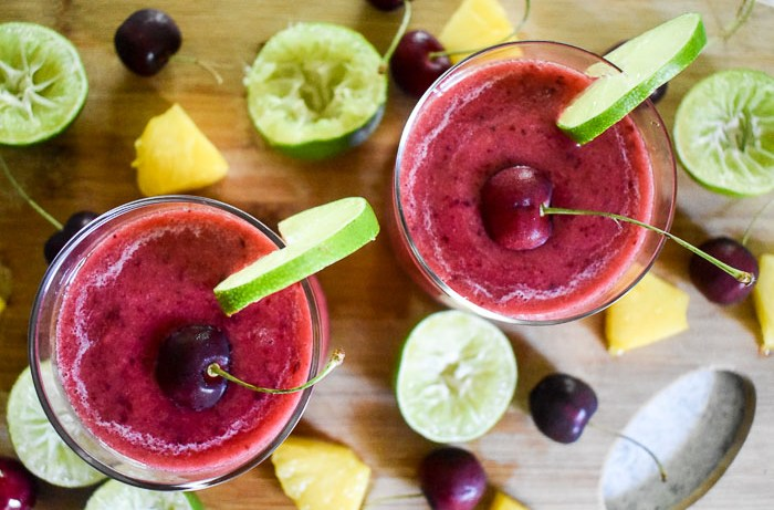 One easy step, two minutes, and five ingredients to make these delicious 2-minute frozen cherry pineapple margaritas! by Dash of Jazz