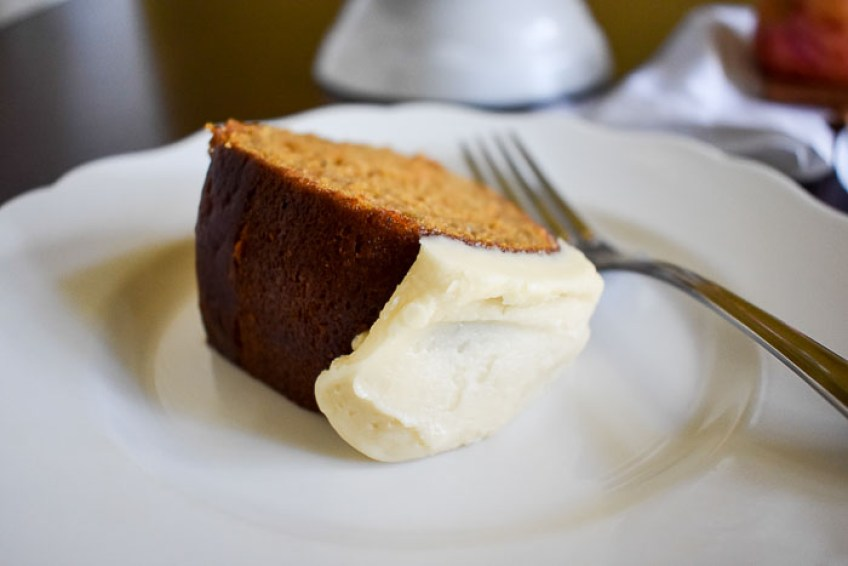 An unbelievably moist and dense pumpkin apple spice cake with Maple Cream Cheese Frosting made from scratch and perfect for the fall and holiday seasons. Recipe by Dash of Jazz