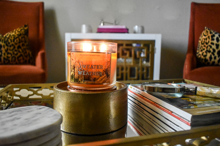 sweater weather candle burning on coffee table tray