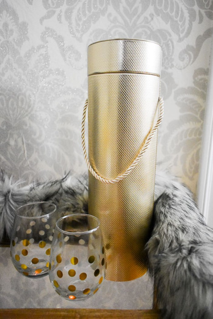 A set of two festive glasses with a bottle carrier are one of Dash of Jazz's 6 easy bottle gift ideas for your host.