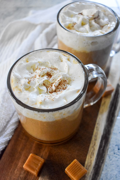 Bourbon Caramel Apple Cider is the perfect cozy fall and winter drink that's ready in under ten minutes in three easy steps and with just 3 simple ingredients! Recipe by Dash of Jazz